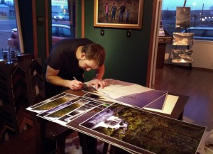 Gavin preparing and adding initial to mounted 24 inch open editions in his gallery. Visit his website for details.